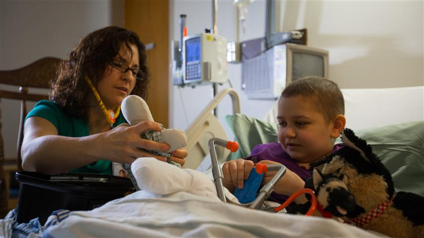 Child in hospital playing with toys