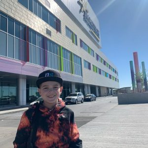 Nate in front of Jim Pattison Children's Hospital after recovering from transplant